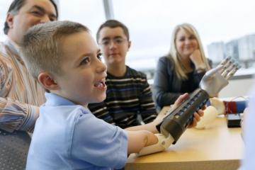 Child with prosthetic arm. Photo credit Ohsu.edu / Kristyna Wentz-Graff