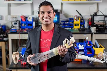 Aadeel Akhtar, an M.D./Ph.D. student at Illinois holding prosthesis. Image credit L. Brian Stauffer and Illinois News Bureau